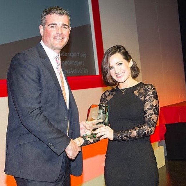 Recieving my award on stage by John Nurse, Director of SportPlan