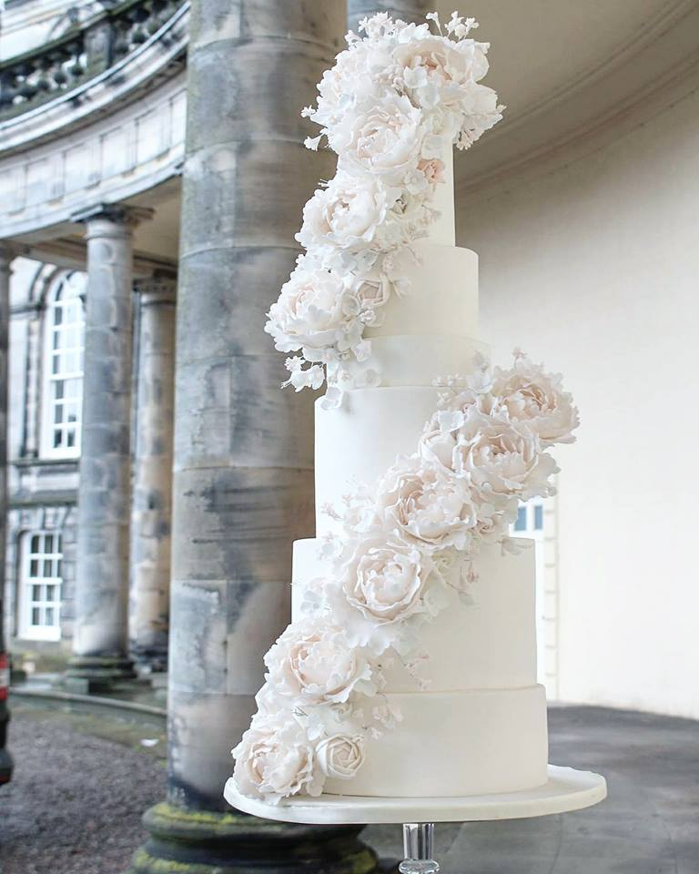 A huge double cascade of sugar peonies over five tiers at the opulent Hopetoun House