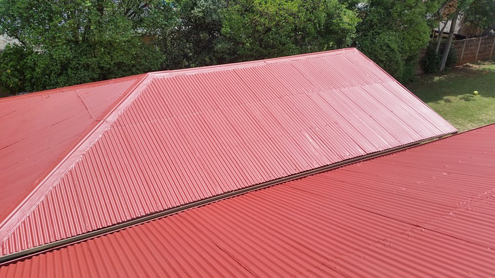 what does the process of roof painting require: - If you are thinking about handling your industrial or household roof painting yourself, think again. It is not as simple as just climbing onto your roof and applying a fresh coat of paint. For starters you will need to use a high pressure cleaner to remove any fungus, dirt, grime and potentially loose paint. On tiled roofs, acrylic patching material is typically used to repair any damage to the ridging and all tiles are checked for damage too. Damaged tiles must be repaired with acrylic material and on tin roofs, all screws are checked and sealed with a latex compound.