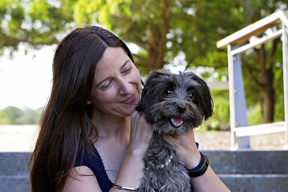Woman gazing with love at her dog during a photo session with Pawtastic Photography at Sydney Park
