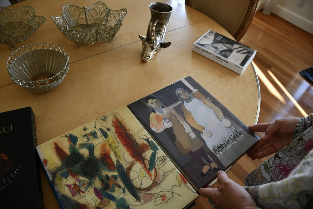 Books about artist Arshile Gorky who lived in Watertown at one time.  Bowls and goblets from Armenia.