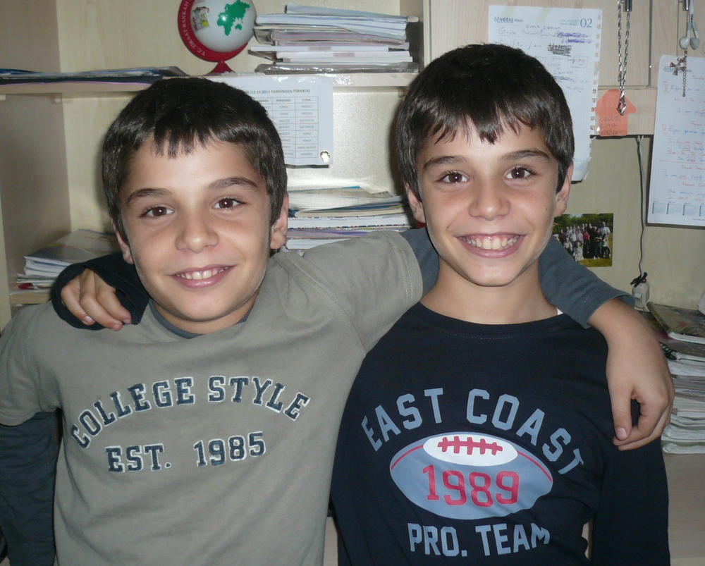 Sayat and Simon are twins and live in Istanbul. Their father is a jeweler from Istanbul and their mother comes from Yozgat in central Turkey.  Sayat likes to play basketball and Simon wants to be a professional footballer when he grows up but they also play computer games together.