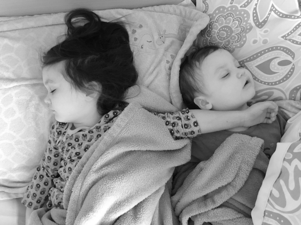 Here's a recent picture of you napping with your sister. Your arm thrown over Emerson's neck is the best.Your mom sends me pictures of you sleeping all the time and I couldn't love anything more. This particular picture reminds me of my favorite picture of your mom and me napping together when we were little. I think I was almost exactly the age you are right now.