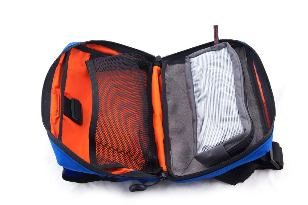 "The interior of the bag features a high-visibility orange liner. One side of the bag features a 14""L x 7""W loop Velcro platform. It comes with a clear front, string-reinforced vinyl, 4""x12""x2"" hook and loop Velcro pouch."