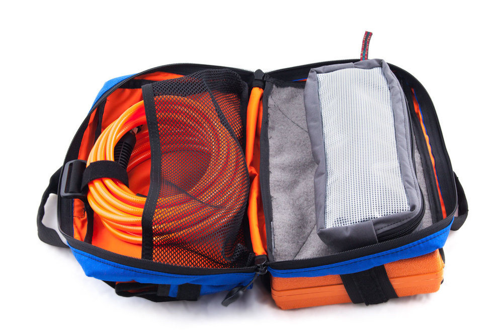 One side of the interior of the bag features a large mesh pouch. It's a great place to store airlines. When the bag is open, it'll lay flat in a clamshell design for maximum accessibility.