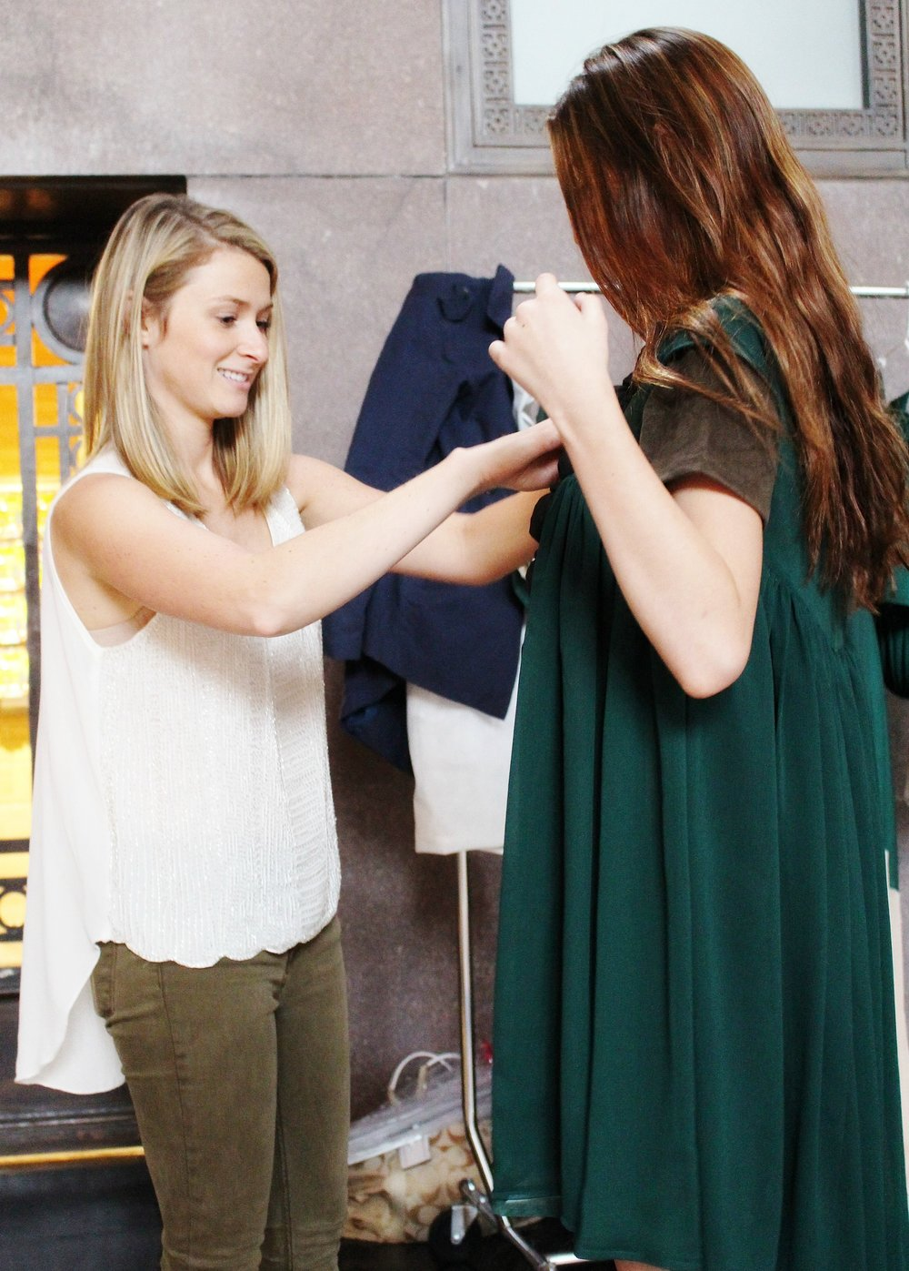 Designer, Laura Higginbotham fitting a model.