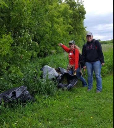In May 2017, the interns removed nearly a dozen large garbage bags full of garlic mustard, an invasive noxious weed, from a tree line on site.