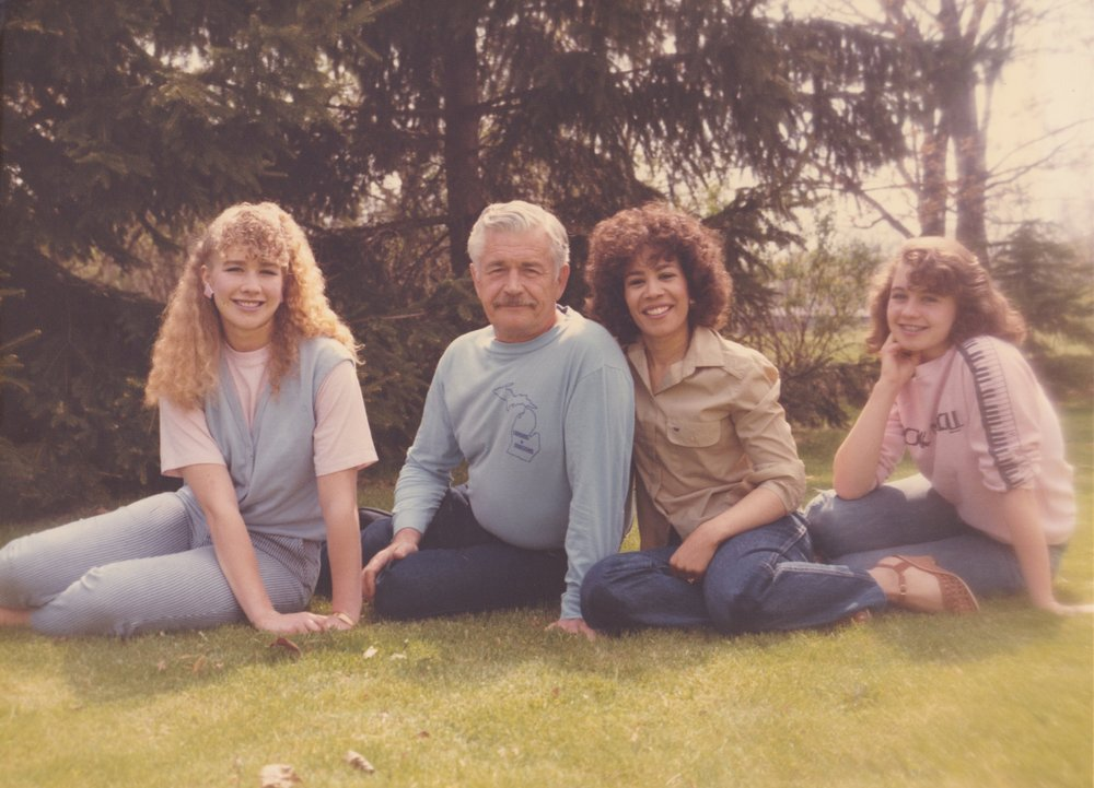 That's our family in 1986 in our backyard in Okemos, Michigan. Our father, Thomas Lee Atkins, was a Roman Catholic priest for 15 years. Our mother, Marylin Atkins,was the organist at his parish. She's also black and 25 years younger than him!They married pre- Loving v. Virginia .After she retired from her position as Chief Judge of Detroit's 36th District Court, she wrote her memoir,  The Triumph of Rosemary  , chronicling her life from her adoption till now, including what she and our father went through when he left the priesthood and they married and had us! Check it out here . Our father kept a journal his whole life, so we are a family of writers. Although he died in 1990, we keep him alive in our conversations and memories of him. Besides, he's always with us in spirit. We know that without a doubt!