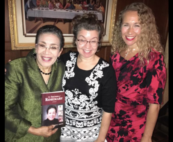 Judge Marylin E. Atkins, holding a copy of her new book, with daughters Catherine Atkins Greenspan and Elizabeth Ann Atkins  Photo Credit: Malesa Owens McGhee