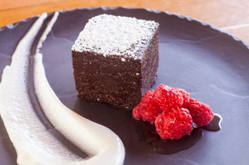 Flourless chocolate cake with raspberries and creme fraiche