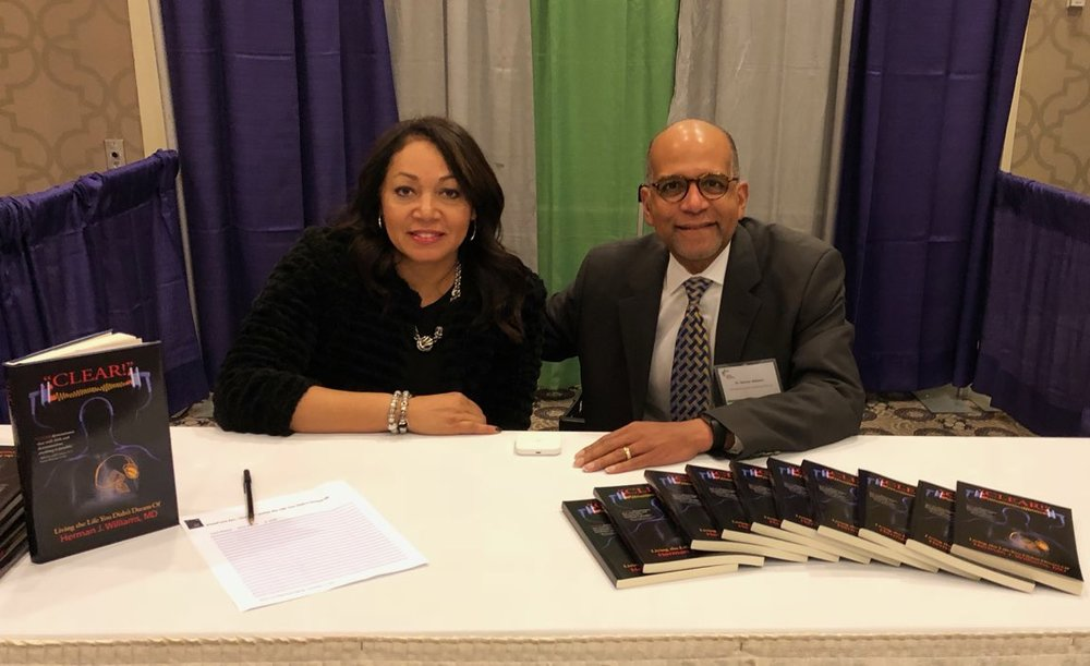 - Herman Williams, MD, and his wife, Jeannie, at a book signing earlier this year.