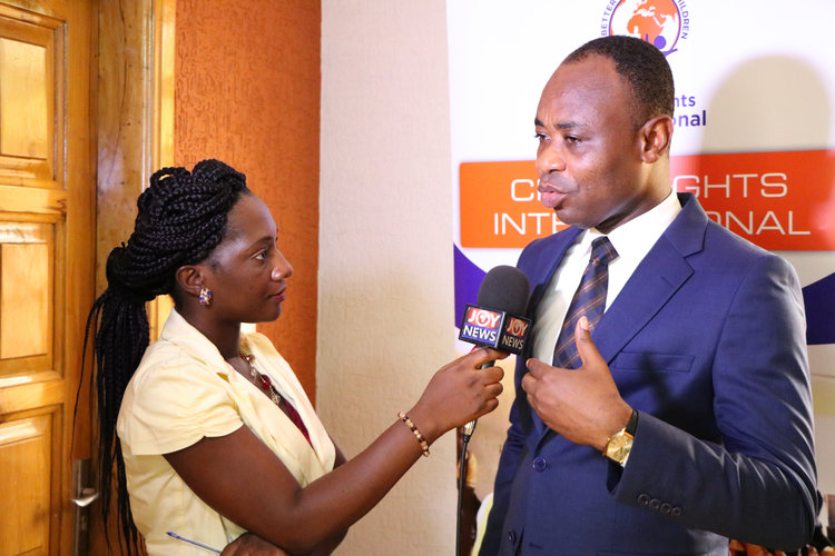 A journalist from JoyNews interviews Executive Director, Bright Appiah