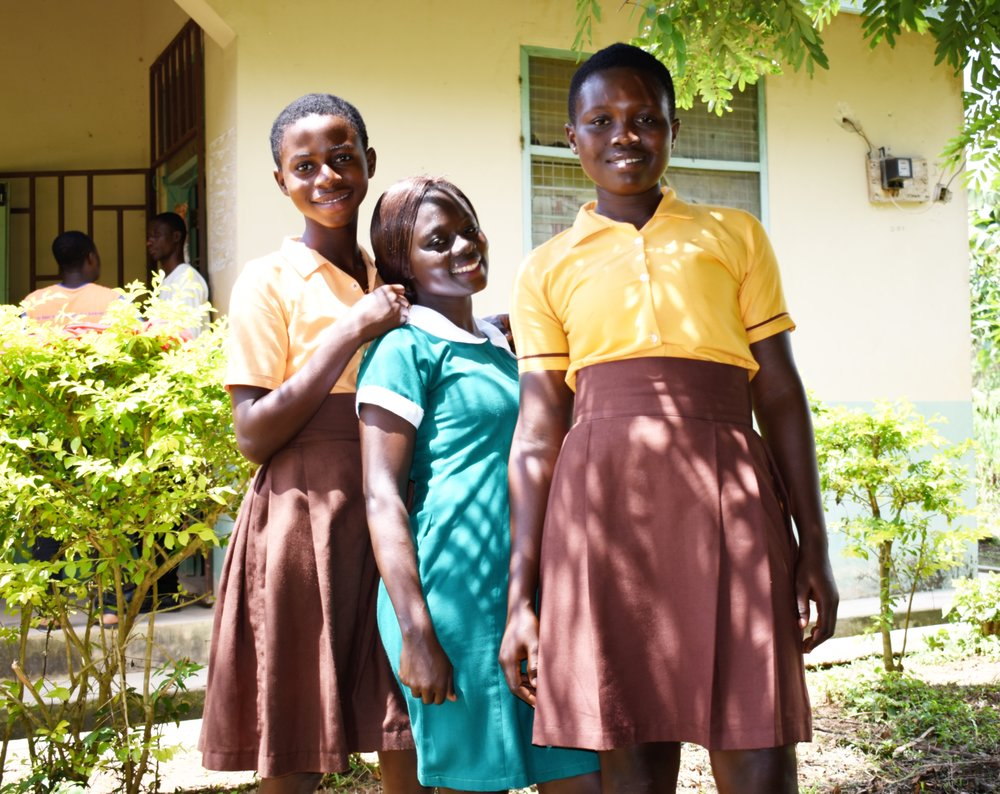Angelina (left) and Jefferys (right) in a pose with Nurse Juliana Bentil
