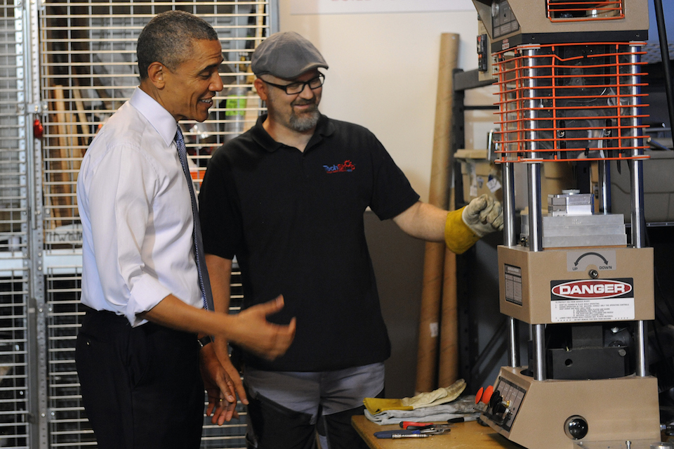 President Obama learns from Terry Sandin about the injection molder, a machine at TechShop Pittsburgh in Bakery Square. (Rebecca Droke/Post-Gazette) Read more: http://www.post-gazette.com/local/city/2014/06/17/Obama-arrives-in-Pittsburgh/stories/201406170170#ixzz352yiQHdz