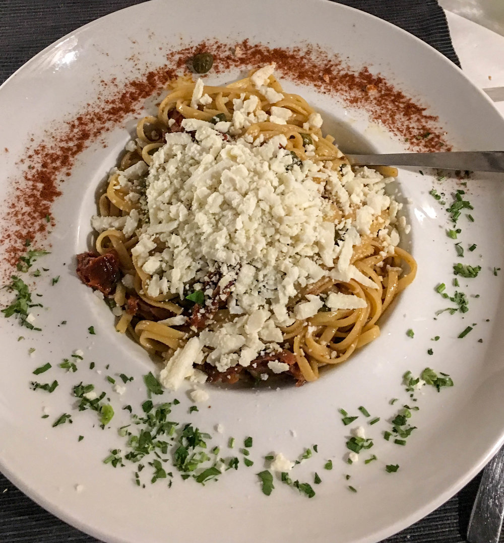 Greek Pasta with sundried tomato, feta, and olives, at Argo, Fira, Santorini, Greece