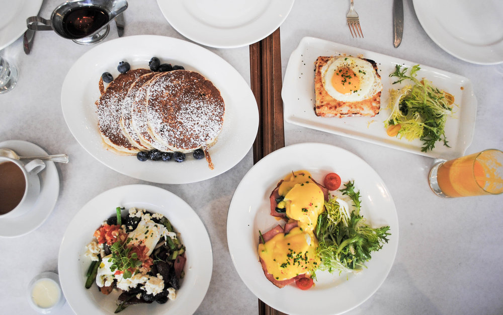 The spread: (clockwise, from top left): Lemon Ricotta Pancakes, Croque Madame, Eggs Benedict, Farmers Market Breakfast