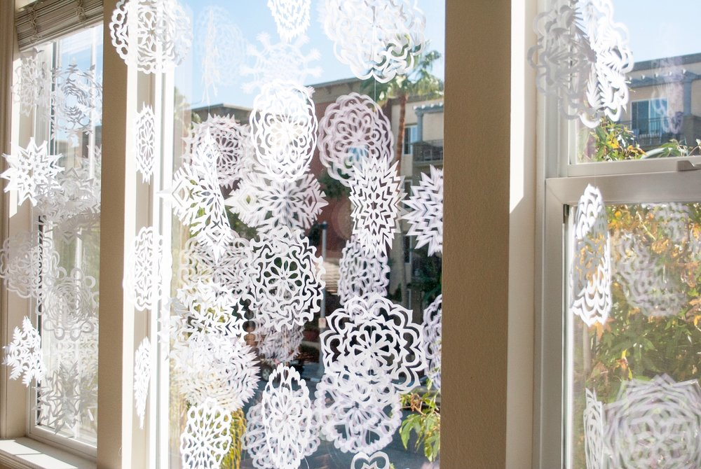 Paper snowflakes hanging in the windows
