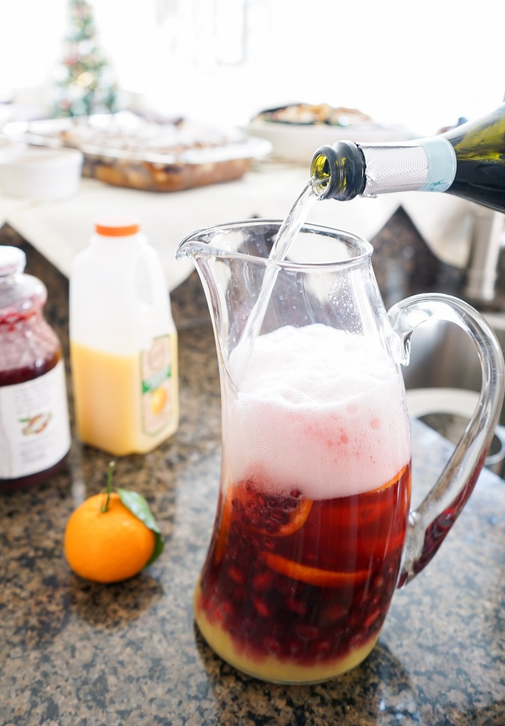 Adding the Prosecco to the Cranberry Mimosa