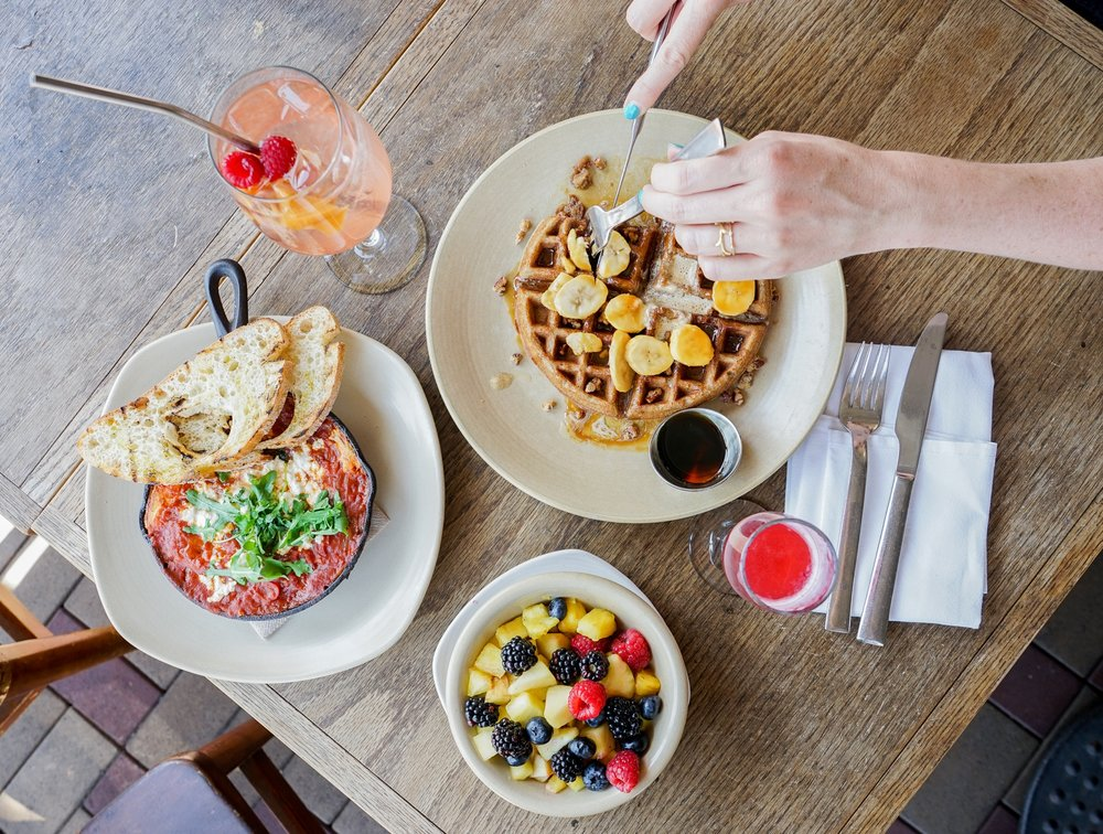Seasonal Sangria, Buckwheat Waffle, Prosecco Fizz, Fruit Salad, and Shakshouka at Akasha Restaurant, Culver City, CA
