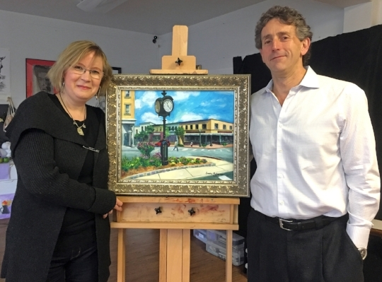 On behalf of the Ridgewood Arts Foundation, artist and a owner of Master Art Studio in Ridgewood, Sasha Robinson, was pleased recently to deliver her painting of the clock in Van Neste square to Ridgewood resident, Mark Needle. Mr. Needle was the silent auction winner at a recent fundraising event hosted by the Ridgewood Arts Foundation