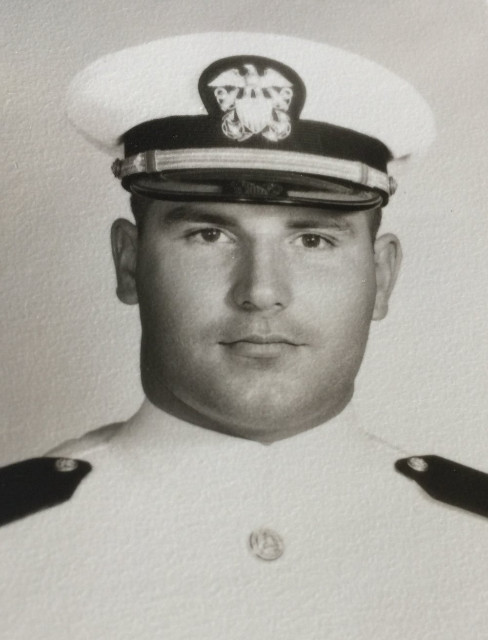 a black and white photograph of Lieutenant Mitchell Porche, Jr., a Caucasian male, in his navy uniform.  Photo Credit Unknown.