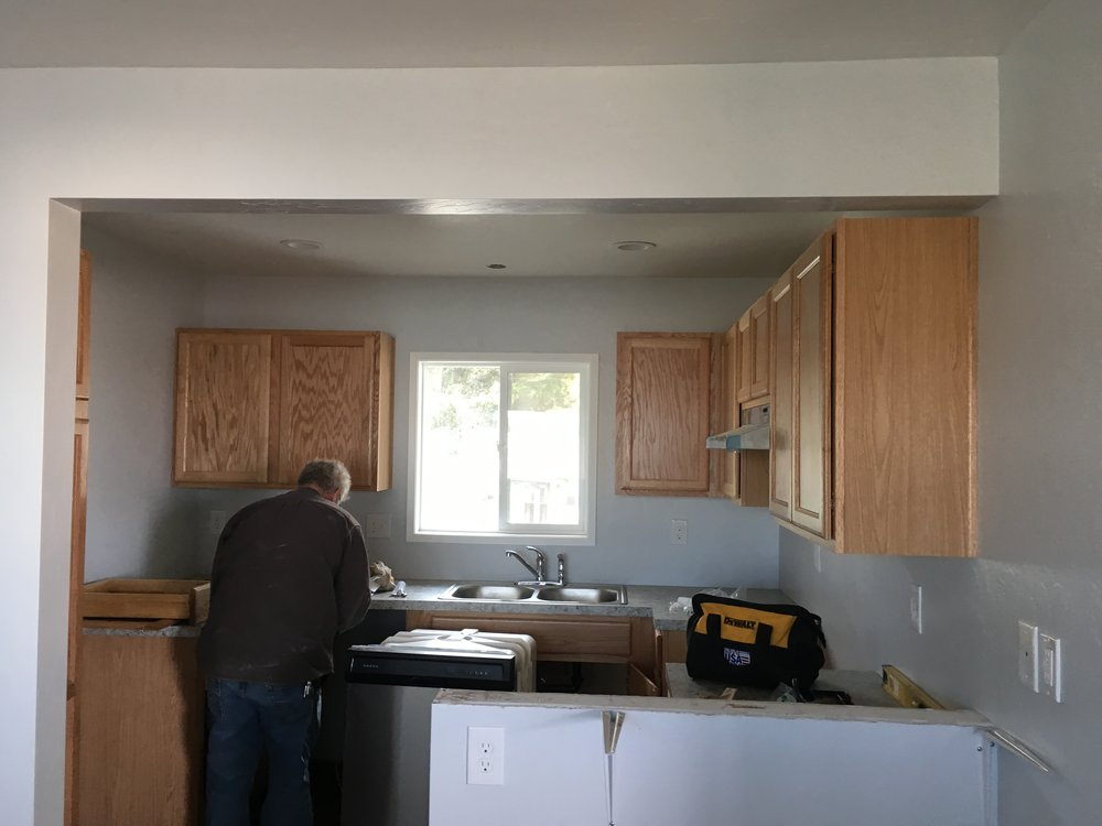 The fire damage is no more.  Brand new paint, new kitchen cabinets and new plastic laminate countertops.