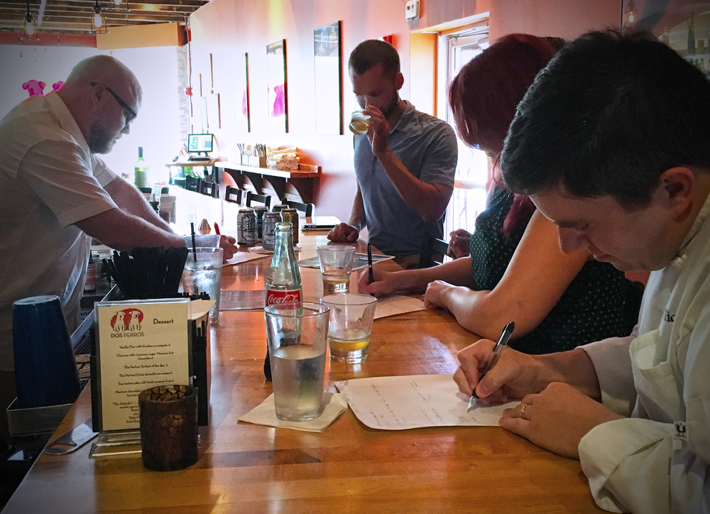 Charlie (left) and Chef Michael (foreground) writing the menu