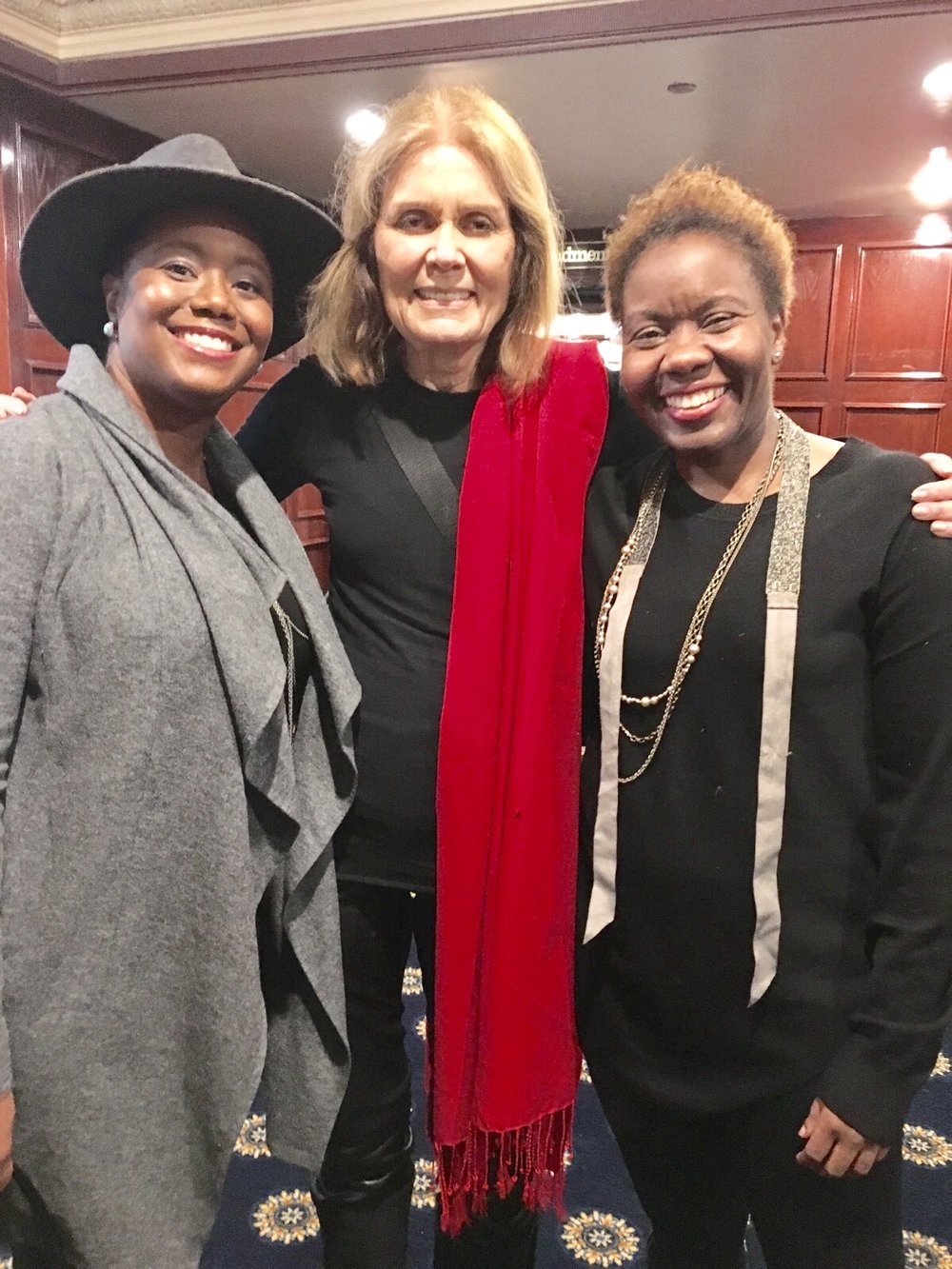 Kimberly Hall of Poverty & Race Research Action Council (wearing the hat); legendary Women's Rights Advocate, Gloria Steinem; and Judithe Registre, Host of the Get InPowered Podcast