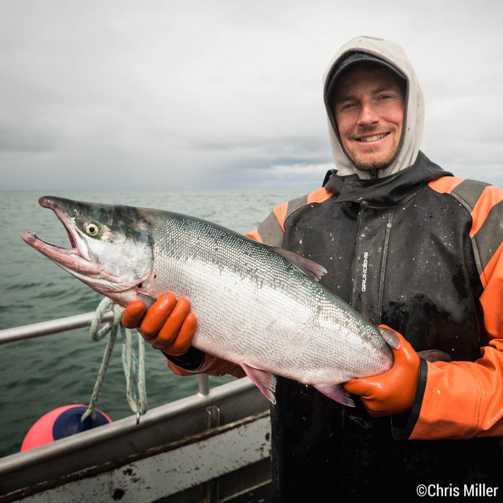Jonathan Adams proudly holds a 10 lb sockeye, a bit bigger than the average of 5-6 pounds. Fishermen take pride in the health and vitality of the Bristol Bay sockeye run.