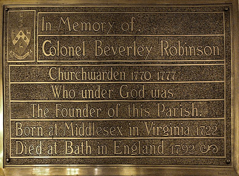 A plaque placed in memory of Beverly Robinson, our first warden, on the back wall of the church near the baptismal font.