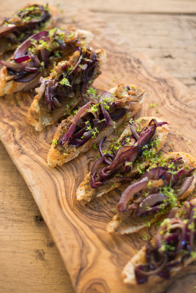 I wanted to make a caramelized onion crostini using D&S porcini mushroom tapenade. Ricky had the idea to top them with lime zest which really sealed the deal!  Here's the recipe for these Porcini Crostini.