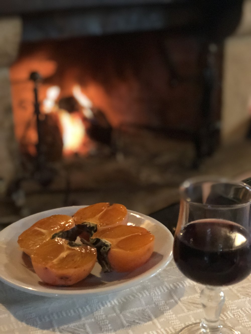 Persimmons and house-made wine for dessert at Agritourismo Bergi