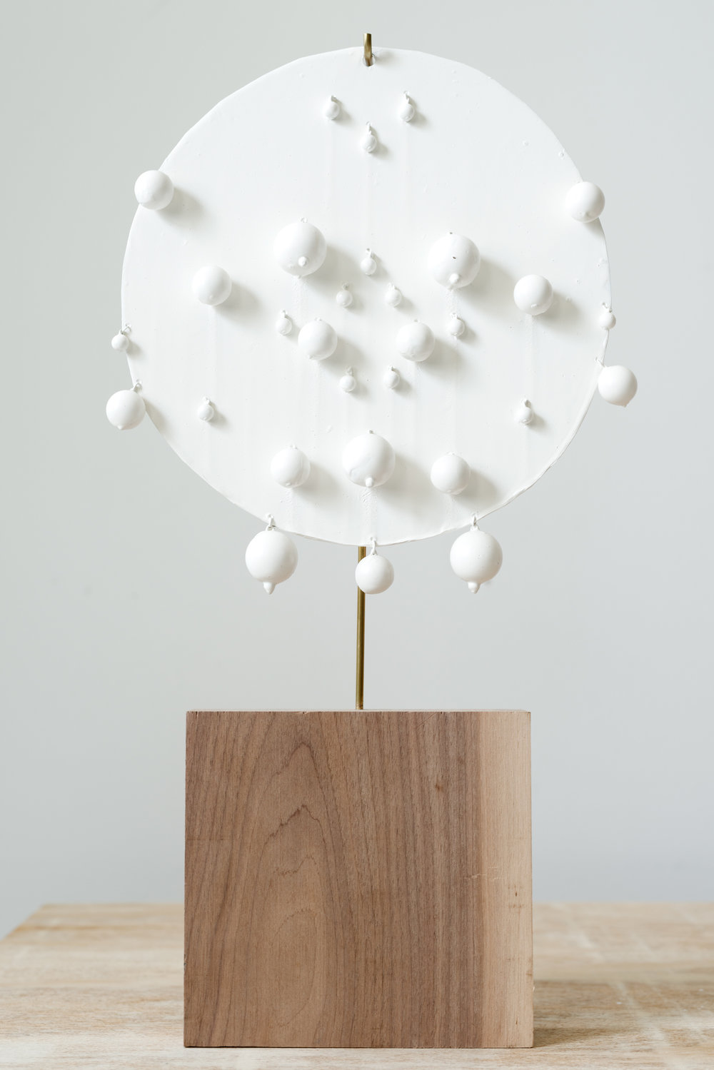 Disk VII,  2012 Acrylic medium coated aluminum, Lucite, brass, wood 19 x 10 x 2 inches