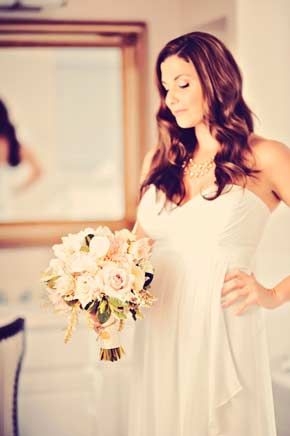 Jane admiring her bridal bouquet