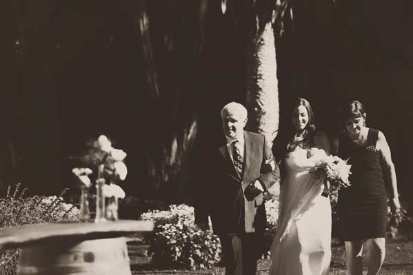 Jane walking down the aisle with her parents