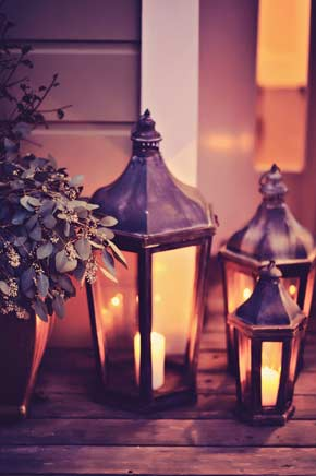 details - metal and glass lanterns with candles