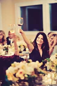 Lena toasting to the newly weds