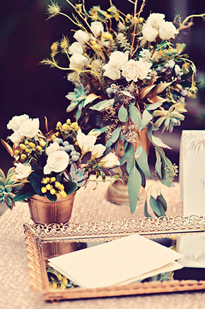 White florals with gray greenery accents and gold