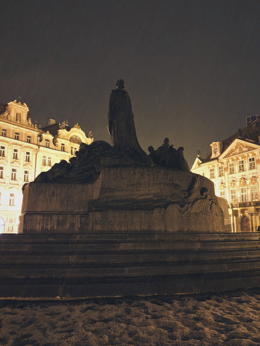 Jan Hus watching over Prague's snowy Old Town Square.