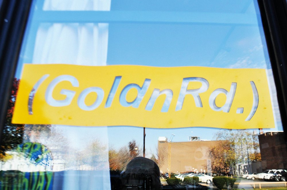 A PHOTO OF THE FRONT WINDOW THE FIRST GOLDNRD STOREFRONT   IN COLLABORATION WITH PANDAMAN TOYS LOCATED ON MONROE AVE, ROCHESTER NY IN 2012
