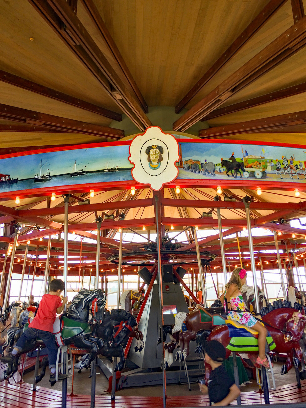Greenport carousel riders.jpg
