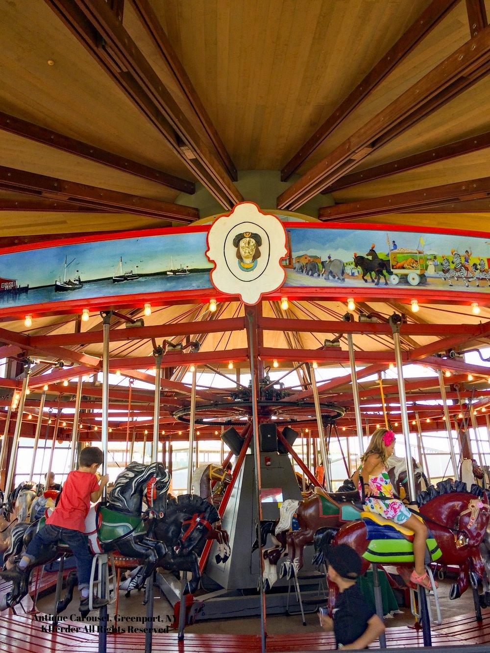 Greenport carousel riders.jpg