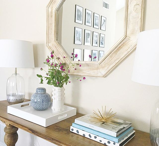 """Fresh blooms for a fresh week. 👊🏻 Lets do this Monday! Also I think I need a new mirror for my entryway. My husband will for sure leave me if I bring another mirror into this place but don't you think I NEED a darker one? """"Need"""" being the key word here. 😜 #decoratingproblems"""