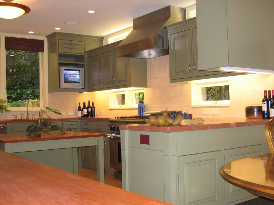 Distressed painted kitchen with hand-fitted flush-inset doors and drawer fronts