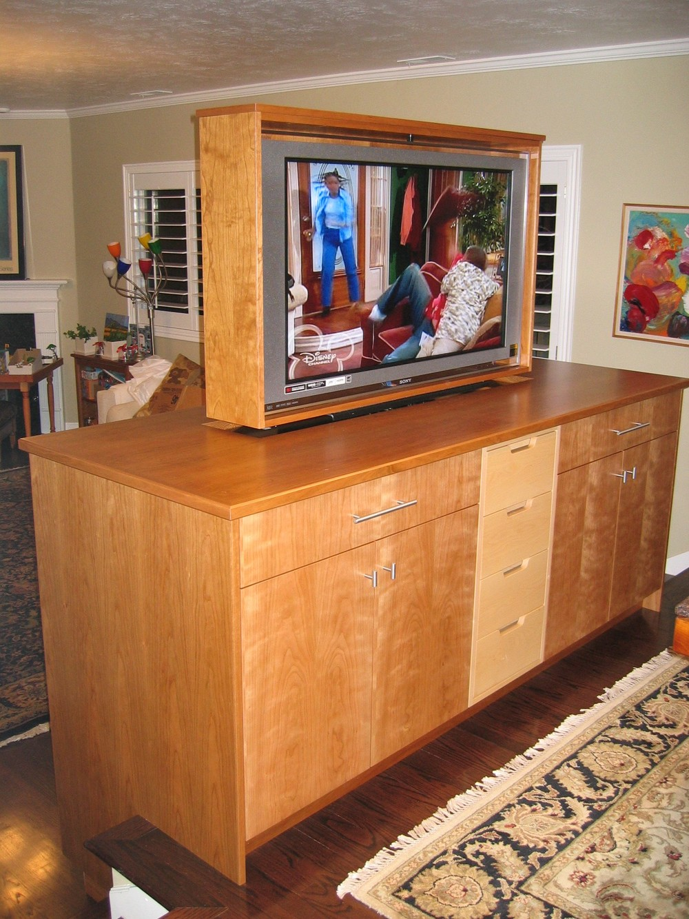 Cherry-maple pop-up, pivot TV cabinet