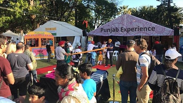Lines are forming for turban-tying at the Punjab Experience stall!  Come on down and give it a go!