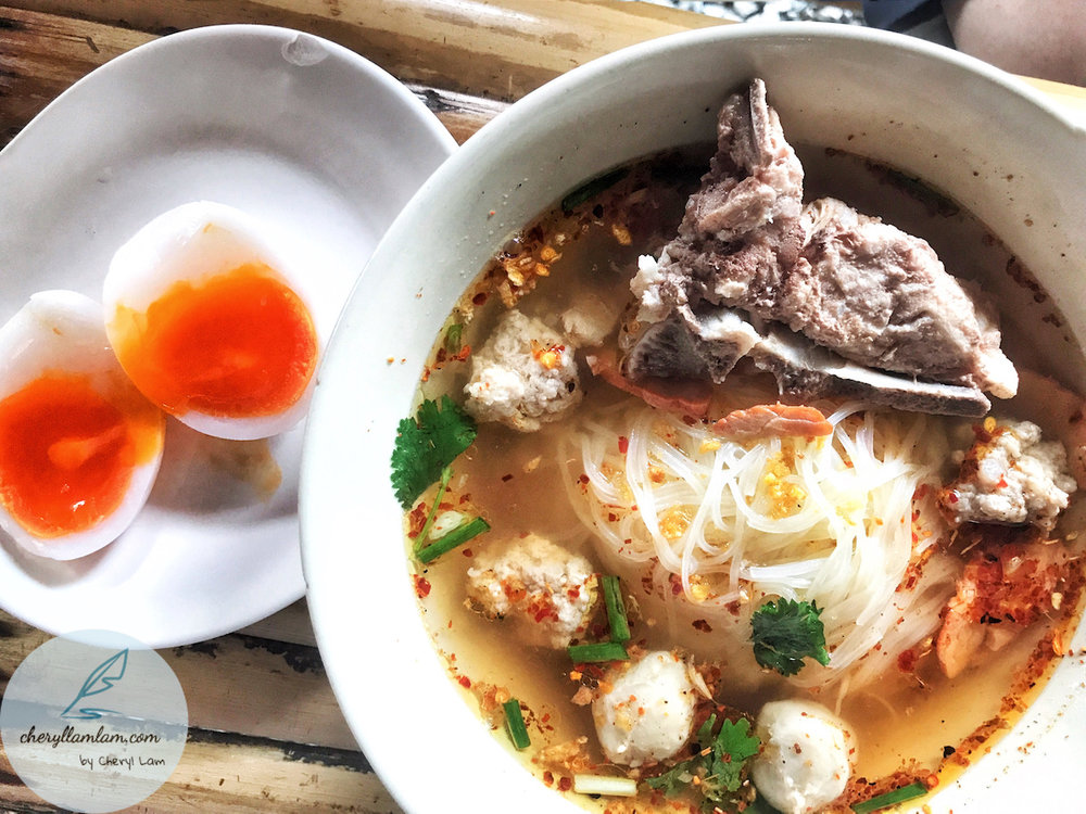 Thai tom yam koay teow soup with duck egg