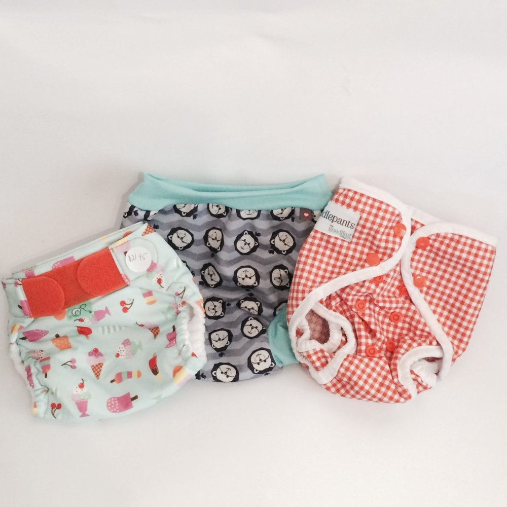 It's warming up and that mean its swim time! It's sale time so check out our range of swim nappies!
