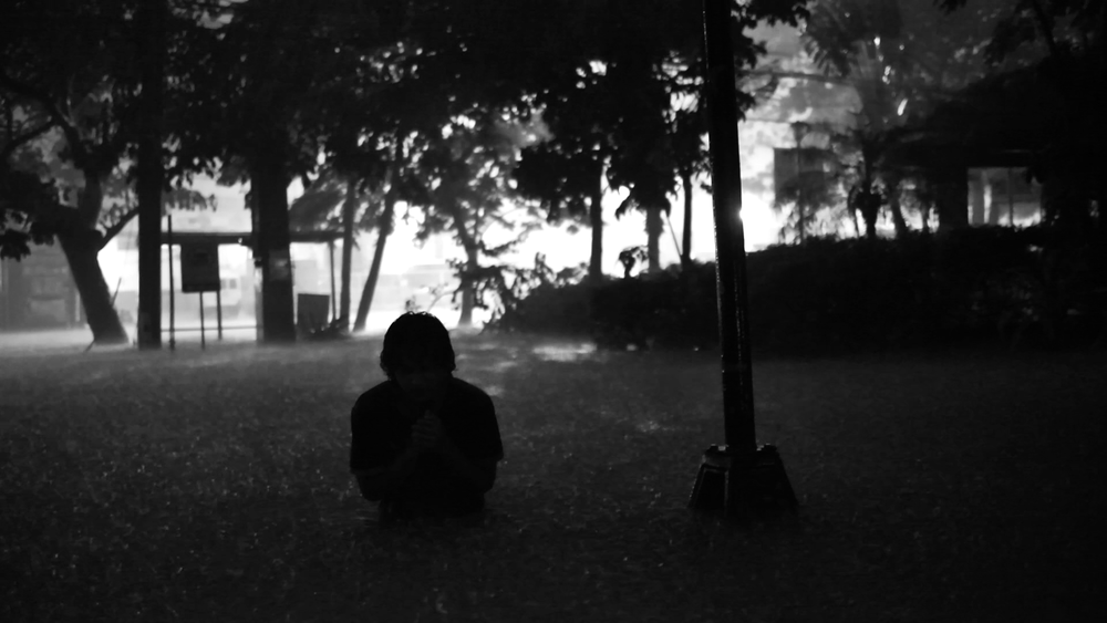 Lav Diaz / Philippines / 2015 / Filipino / 16min   In the year 2050, the Philippines braces for the coming of the fiercest storm ever to hit the country. As the wind and waters start to rage, poets are being murdered.   Director:  Lavrente Indico Diaz, aka Lav Diaz, is a filmmaker from the Philippines, born on December 30, 1958 and raised in Cotabato, Mindanao. He works as director, writer, producer, editor, cinematographer, poet, composer, production designer and actor all at once. He is especially notable for the length of his films, some of which run for up to eleven hours. That is because his films are not governed by time but by space and nature. His films dig into the social and political struggles of his motherland and through these, he has garnered the admiration of the international festival circuit.