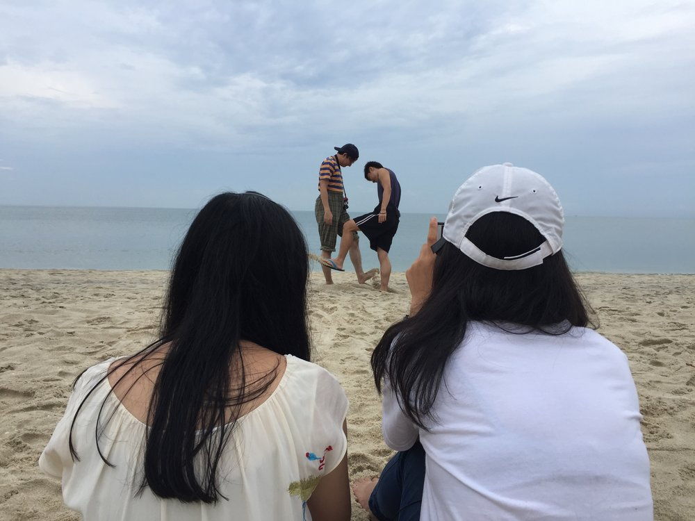 """""""It was never easy to direct friends. When the conversation between Rui and Xian on the beach ended, Isyraqi and Jacky had fun in tucking their shirts in and kicking sand at each other."""" -Elise Shick"""